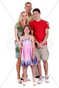 Happy family of four standind and looking at you Stock Photos