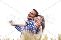 Couple enjoying the breeze in the park Stock Photos