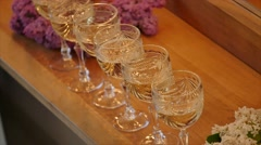 Elegant Glasses with Champagne Standing in a Row Stock Footage