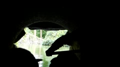 Silhouette of a Group of Tourists Riding on the Boat in Underground River. Stock Footage