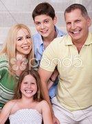Portrait of happy family of four Stock Photos