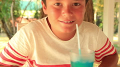 Young boy drinking a summer drink Stock Footage