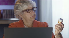 Senior woman doing internet search about prescription drugs Stock Footage