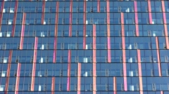 Master shot colorful glass wall of commercial office building Stock Footage