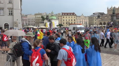 WYD Krakow 2016 - Main square by rainy day, colored crowd with umbrellas & coats Stock Footage
