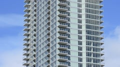 Middle of high rise condominium with blue sky Stock Footage
