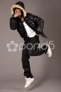 Black acrobat man dancing in studio Stock Photos