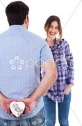 Young man hiding the gift from her girlfriend Stock Photos