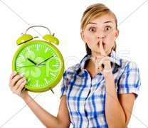 Girl with the clock asking us to maintain silence Stock Photos