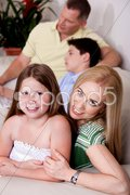 Family of four relaxing at home Stock Photos