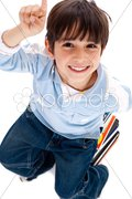 Little boy pointing up - stock photo