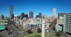 Good aerial fly by of the Robert E Lee statue reveals downtown New Orleans, Stock Footage