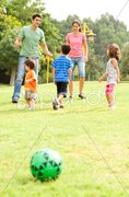 Family spending their leisure time in the park - stock photo