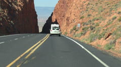Driving down AZ Rt 89 thru slot crevice Glen Canyon Nat History Stock Footage