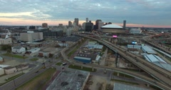High angle aerial shot reveals the New orleans Louisiana skyline with Superdome Stock Footage