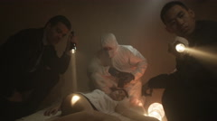 4K Police detectives & forensics team investigating dead body at a crime scene Stock Footage