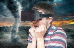 3D simulation concept. Man is wearing virtual reality headset and is scared f Stock Photos