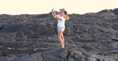 Hiking Girl taking picture with lava in Kilauea volcano Hawaii Stock Footage