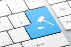 Law concept: Gavel on computer keyboard background Stock Illustration