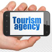 Vacation concept: Hand Holding Smartphone with Tourism Agency on display Stock Illustration