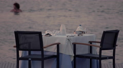 4K romantic dinner table with sea view at dusk Stock Footage