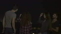 The people stand on the background of the city light. Evening night time Stock Footage