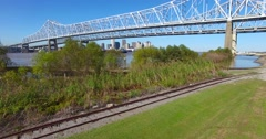 Rising shot of the Crescent City Bridge over the Mississippi River reveals the Stock Footage