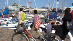 Many tourists, boats and onlookers on the quay in Helsinki. Stock Footage