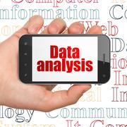 Data concept: Hand Holding Smartphone with Data Analysis on display Stock Illustration