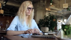 Girl Enters Credit Card Information Into a Laptop in a Cafe Stock Footage