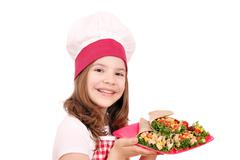 Little girl cook with burritos fast food Stock Photos