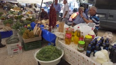 Peasants sell their products at the farmers market Stock Footage