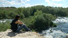 Gril looking on extreme rafting at turbulent rough river Stock Footage