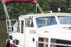 Motor boat in a marina. Kuvituskuvat