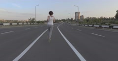 A girl while jogging in park Stock Footage