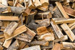 Harvesting of wood for the heating season in winter, solid fuel Stock Photos