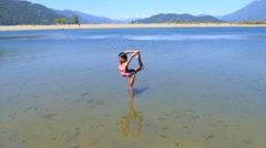 Cute Asian Girl Does Scorpion Pose In The Lake Stock Footage