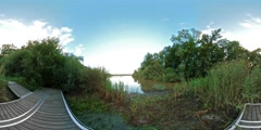 360 VR Nature reserve clouds time-lapse with large duck pond Stock Footage