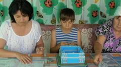 The family at the table playing a game Stock Footage
