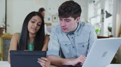 Young male and female student should be working but are easily distracted Stock Footage