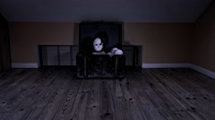 4k Halloween Shot of a Child crawling from a Vintage Chest with a Mask Stock Footage