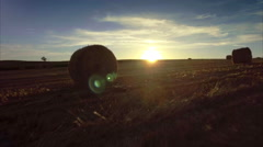 Countryside rural sunset field sky hay bales aerial forward motion sun horizon Stock Footage