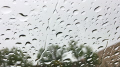 Close up of water drops running on car windshield Stock Footage