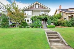 American family house exterior with perfectly kept lawn .Northwest, USA Stock Photos