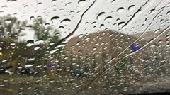 Close up of water drops running on car windshield with sound Stock Footage