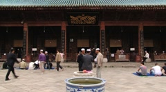 Chinese men visit the Great Mosque in Xian, China. Stock Footage