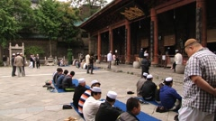 Chinese men pray in the Great Mosque in Xian, China. Stock Footage
