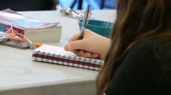 Female Student Diligently Takes Notes In Class - stock footage