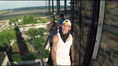 Performing at the height of the tricks. Young guys perform tricks on high-rise Stock Footage