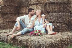 Loving couple retired to the straw. Stock Photos